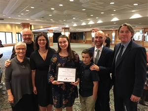 Kelly Phillips pictured with her family and Ged O'Donnell, principal