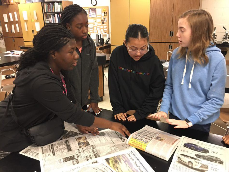 HS Students collaborate in class