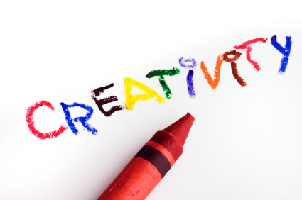 a red crayon with the word creativitiy written in different colors