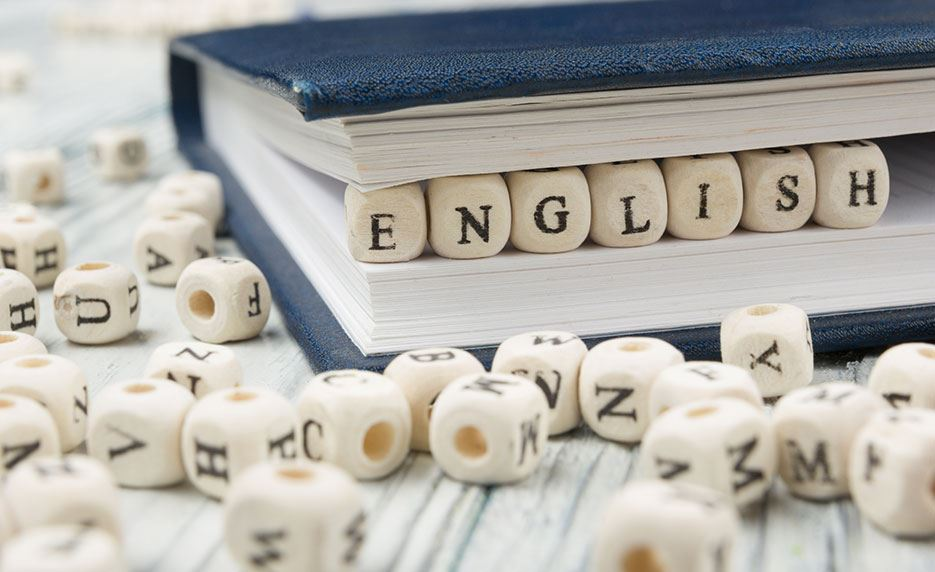 The word English in white beads