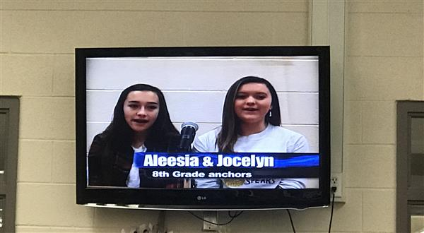 Two news crew members on the television Aleesia and Jocelyn